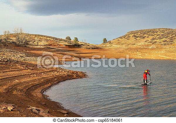 winter stand up paddling in Colorado - csp65184061