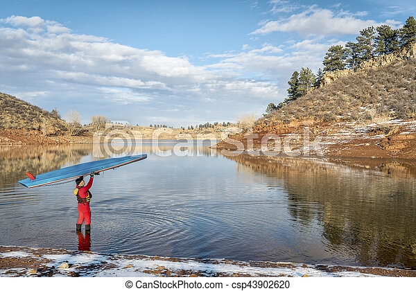 winter stand up paddling in Colorado - csp43902620