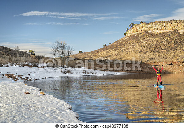 winter stand up paddling in Colorado - csp43377138