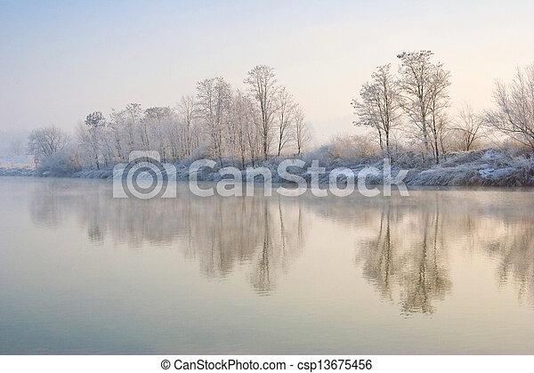 Winter sunrise over the river - csp13675456