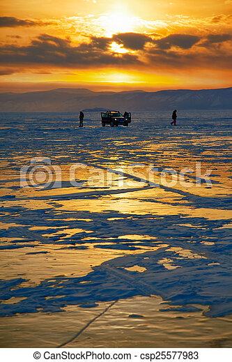 Winter sunset over Baikal lake - csp25577983