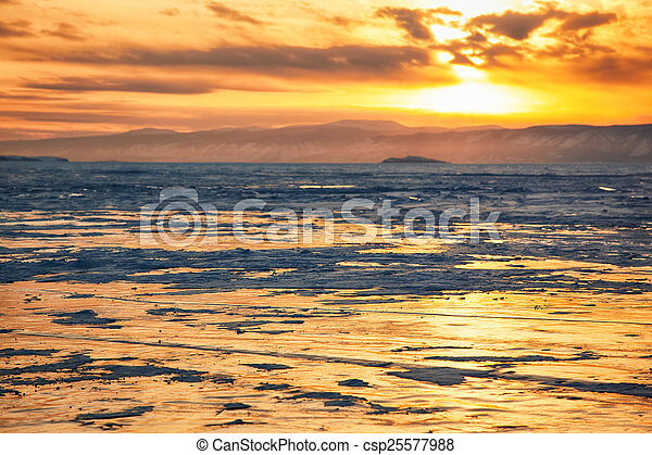 Winter sunset over Baikal lake - csp25577988