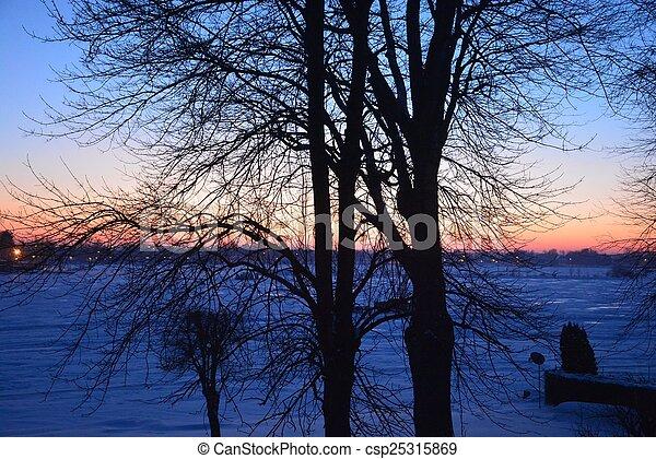 Winter sunset over northern lake - csp25315869