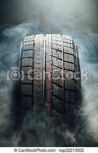 winter tire in smoke - csp32213502