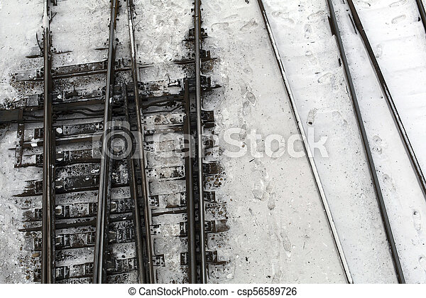 Winter top view on railway tracks and switch in snow background - csp56589726