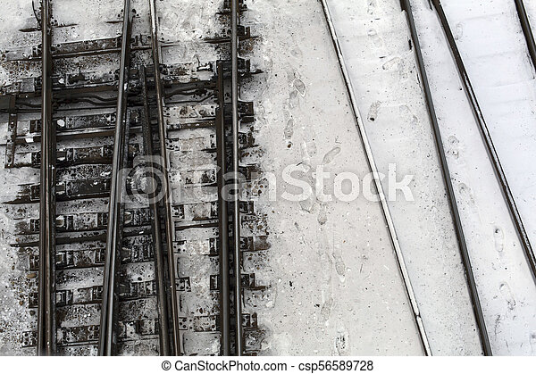 Winter top view on railway tracks and switch in snow background - csp56589728