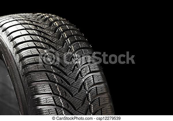 winter tyre on black - csp12279539