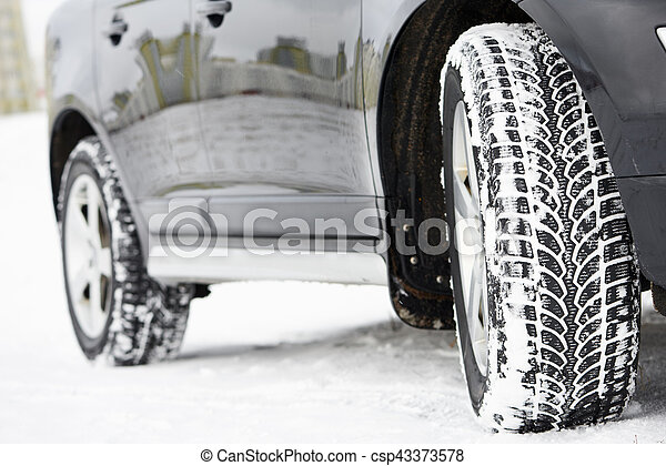 Winter tyres wheels installed on suv car outdoors - csp43373578