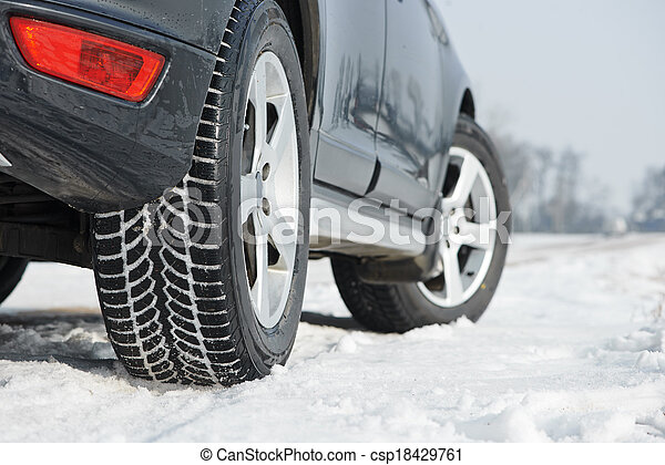 Winter tyres wheels installed on suv car outdoors - csp18429761