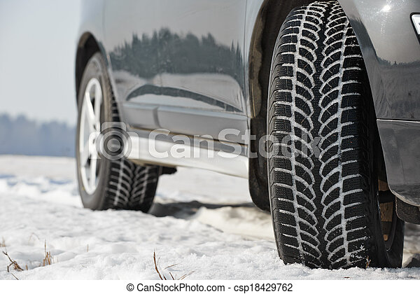 Winter tyres wheels installed on suv car outdoors - csp18429762