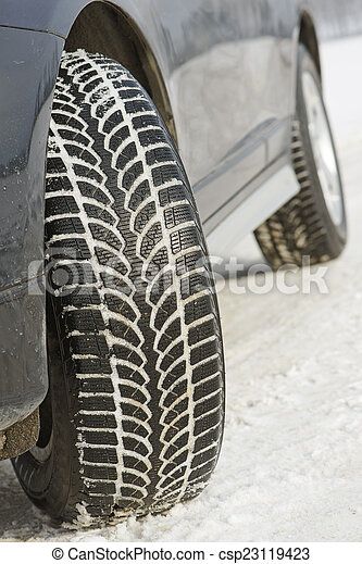 Winter tyres wheels installed on suv car outdoors - csp23119423