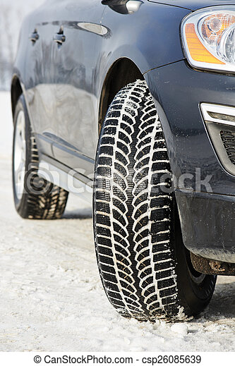 Winter tyres wheels installed on suv car outdoors - csp26085639