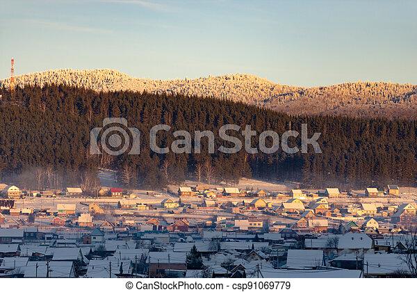 Winter Ural village at sunset - csp91069779