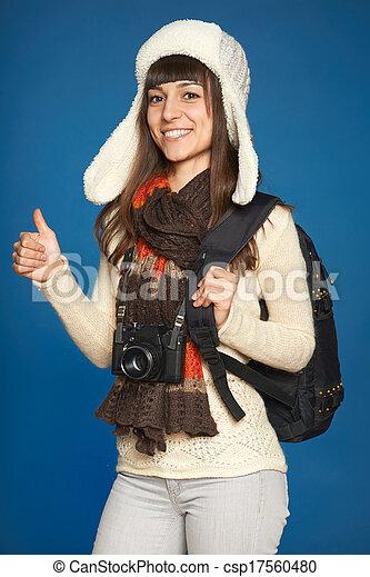 Winter woman traveler with photo camera - csp17560480