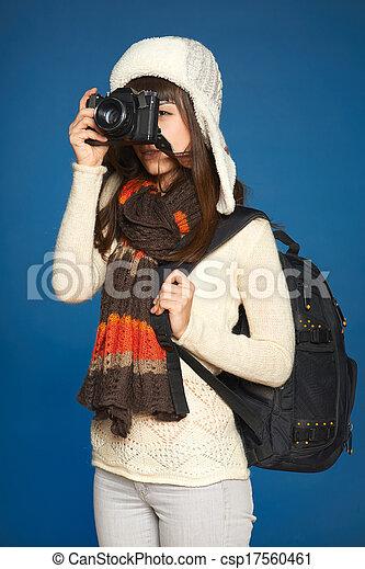 Winter woman traveler with photo camera - csp17560461