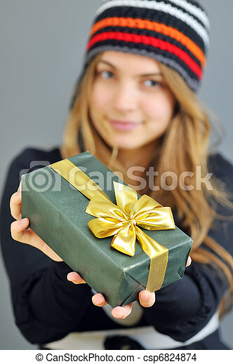 winter woman with gift - csp6824874