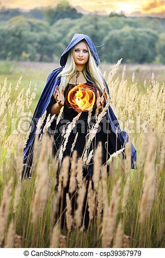 witch holding a fireball - csp39367979