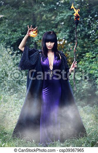 witch holding a fireball - csp39367965