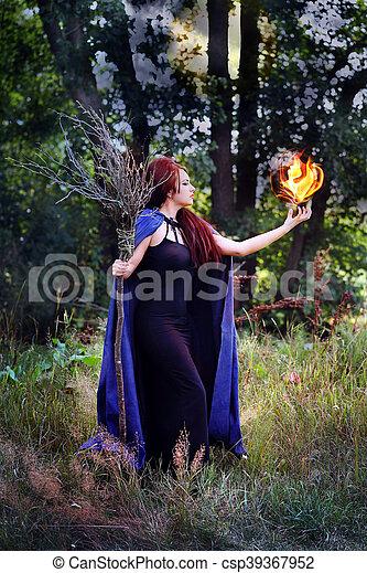 witch holding a fireball - csp39367952