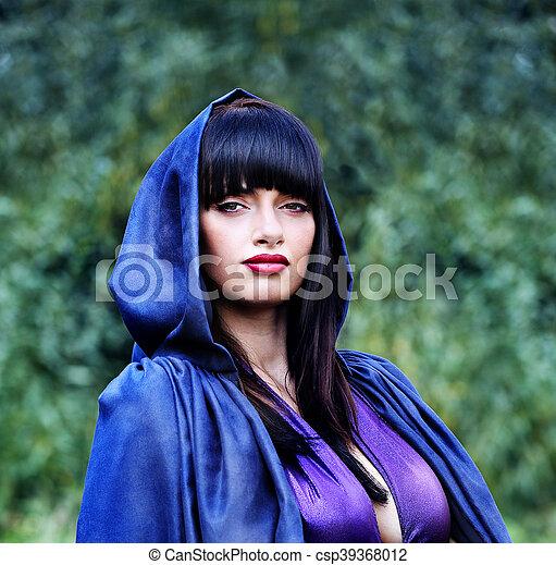 witch in a blue cloak - csp39368012