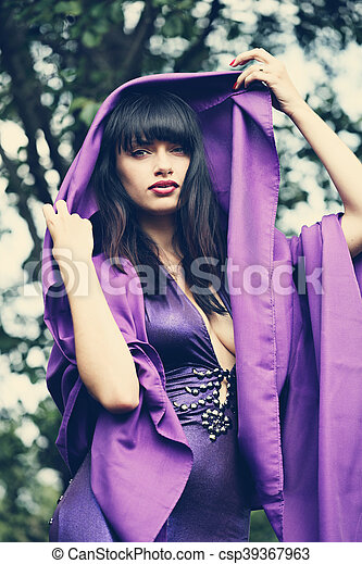 witch in a purple cloak - csp39367963