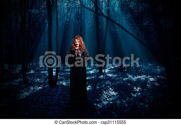 Witch in night forest - csp31115555