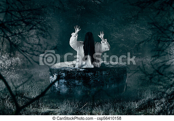 Witch in white shirt gets out of an abandoned well - csp56410158