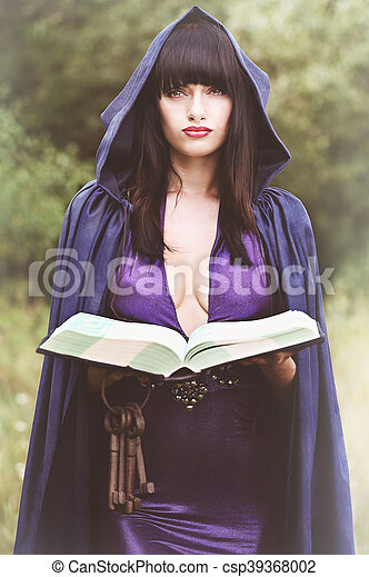witch with a book - csp39368002