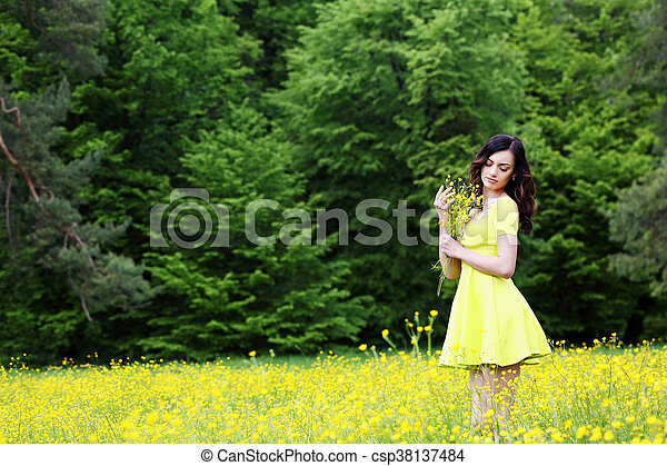 with a bouquet of buttercups - csp38137484