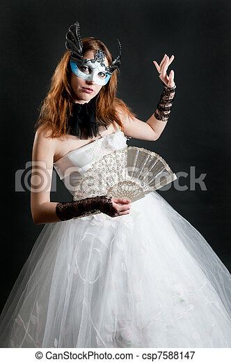 with fan and mask in white dress - csp7588147