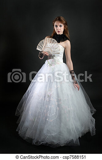 with fan in white dress - csp7588151