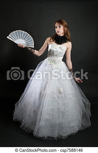 with fan in white dress - csp7588146