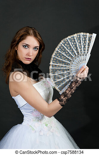 with fan in white dress - csp7588134
