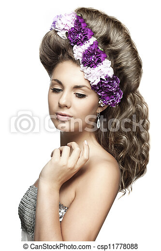 with flowers in a beautiful hairstyle - csp11778088