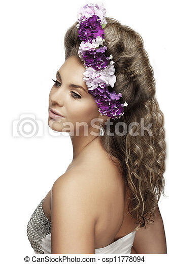with flowers in a beautiful hairstyle - csp11778094