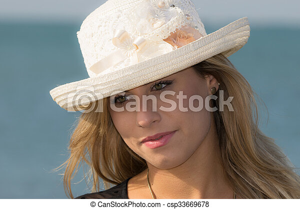 with straw hat - csp33669678