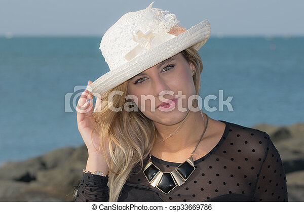 with straw hat - csp33669786