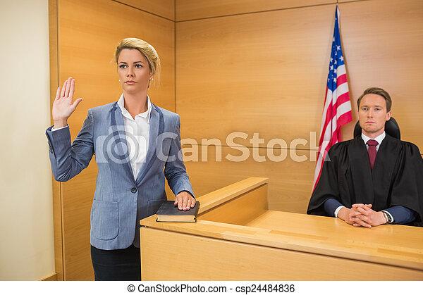 Witness taking an oath - csp24484836