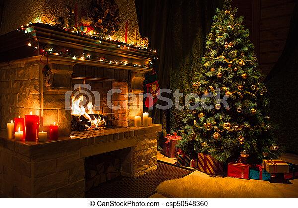Wohnzimmer baum inneneinrichtung dekoriert kaminofen - Weihnachten wohnzimmer ...