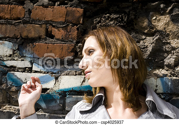 Woman Against A Brick Wall - csp4025937