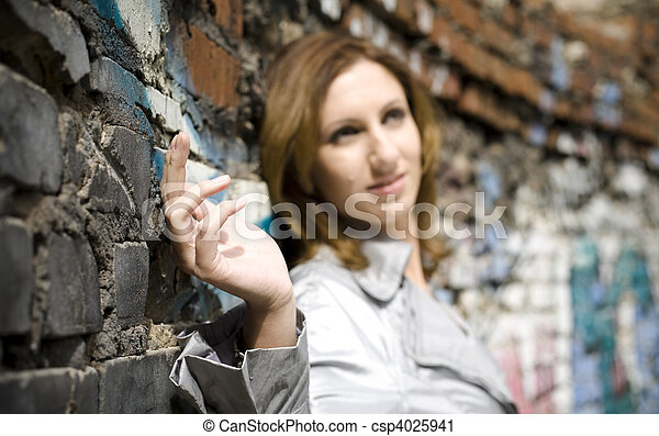 Woman Against A Brick Wall - csp4025941