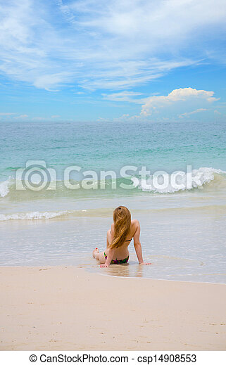 woman alone sit on the beach  - csp14908553