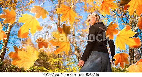 Woman and autumn leaves in the park. - csp15264310