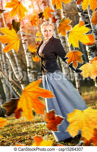 Woman and autumn leaves in the park. - csp15264307