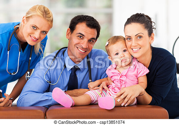 woman and baby girl with health workers - csp13851074