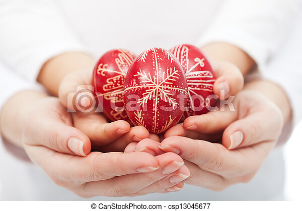 Woman and child hands holding easter eggs - csp13045677