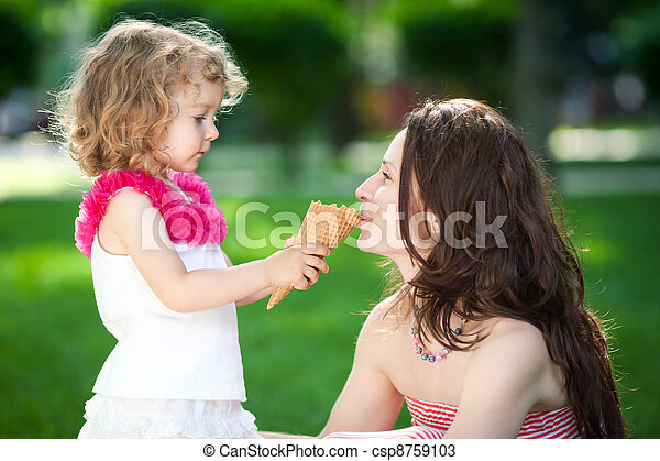 Woman and child in spring park - csp8759103
