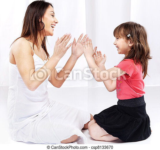 Woman and child laughing and playing - csp8133670