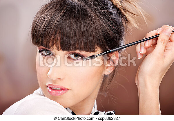Woman and cosmetic makeup - csp8362327