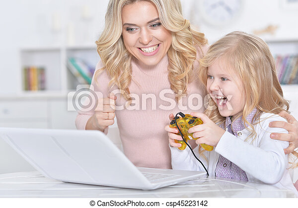 woman and girl playing video game - csp45223142